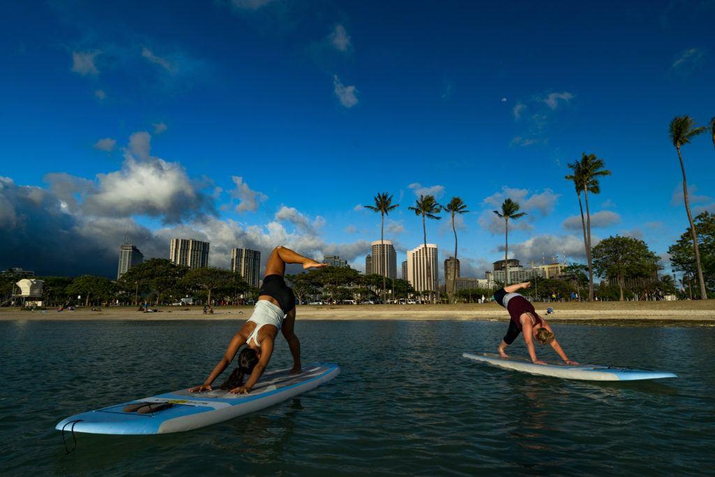 sunset paddle board yoga class oahu